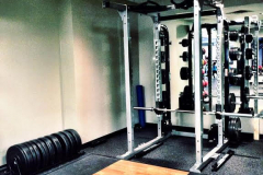 Rep1 Fitness personal trainer squat rack